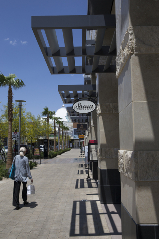 Shoppers walk through Downtown Summerlin, Wednesday, May 25, 2016, in Las Vegas. Approximately 17 million people have visited Downtown Summerlin, and mixed use development will add 12 new brands i ...