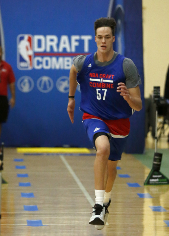 Stephen Zimmerman, from UNLV, participates in the NBA draft basketball combine Friday, May 13, 2016, in Chicago. (AP Photo/Charles Rex Arbogast)