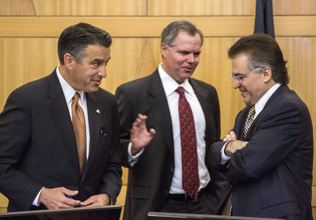 Nevada Gov. Brian Sandoval, left, Jim Murren, CEO of MGM Resorts International, and Tony Alamo, chairman of Nevada Gaming Commission, talk during the Gaming Policy Committee meeting at the Clark C ...