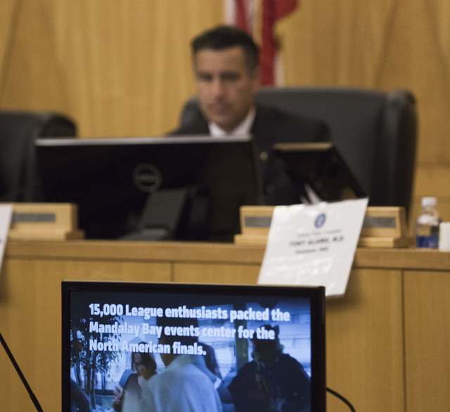 Nevada Gov. Brian Sandoval watches a video on e-sports during the Gaming Policy Committee meeting at the Clark County Commission chambers, 500 S. Grand Central Pkwy. on Friday, May 13, 2016. Jeff  ...