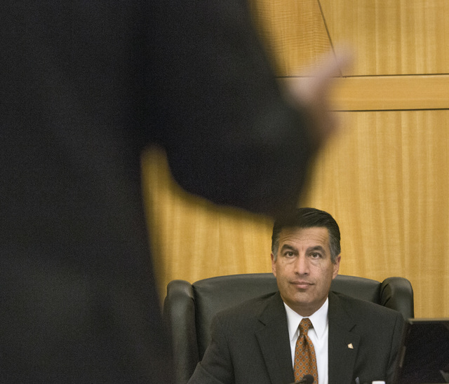Gov. Brian Sandoval listens while Steve Hill, director, Governor's Office of Economic Development, speaks during the Gaming Policy Committee meeting to discuss e-sports at the  County Commission c ...