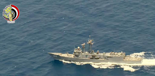 In this Thursday, May 19, 2016 video image released by the Egyptian Defense Ministry, an Egyptian ship searches in the Mediterranean Sea for the missing EgyptAir flight 804 plane which crashed aft ...
