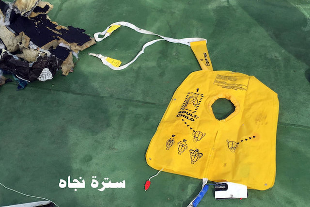 "Recovered debris of the EgyptAir jet that crashed in the Mediterranean Sea is seen with the Arabic caption ""life jacket"" in this handout image released May 21, 2016 by Egypt's mi ..."