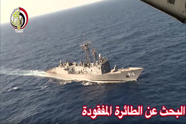 In this Thursday, May 19, 2016 video image released by the Egyptian Defense Ministry, an Egyptian plane flies over a ship during the search in the Mediterranean Sea for the missing EgyptAir flight ...