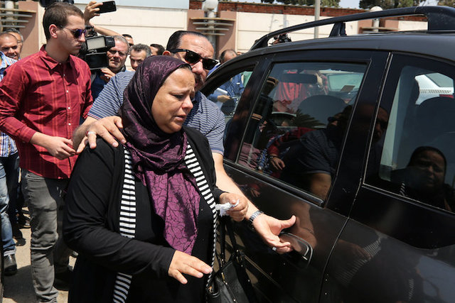 Unidentified relatives and friends of passengers who were flying in an EgyptAir plane that vanished from radar en route from Paris to Cairo react as they wait outside the Egyptair in-flight servic ...