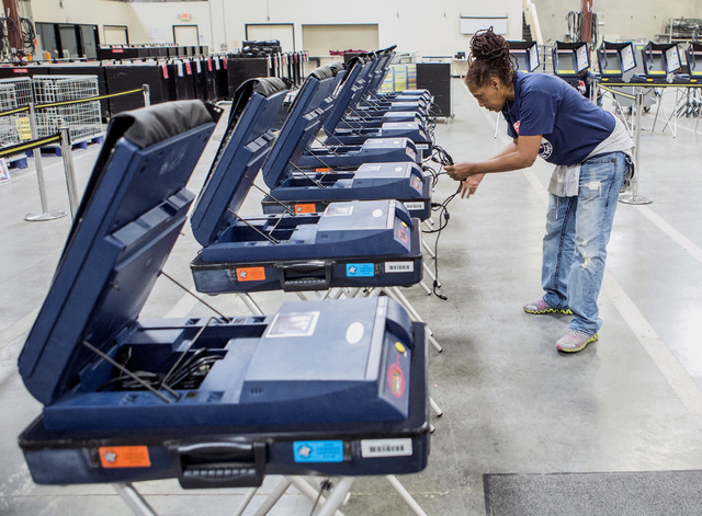 Program assistant Connie Sneed sets up voting machines during a training session at the Clark County Elections Department warehouse, 965 Trade Drive, North Las Vegas, on Thursday, May 12, 2016. Je ...