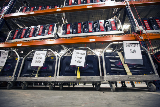 A secured and certified voting machines sits on a carts at the Clark County Elections Department warehouse, 965 Trade Drive, North Las Vegas, on Thursday, May 12, 2016. Jeff Scheid/Las Vegas Revie ...