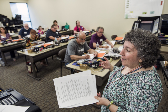 Election program supervisor Maria Tsarouhas, right, conducts training for poll workers at the Clark County Elections Department warehouse, 965 Trade Drive, North Las Vegas, on Thursday, May 12, 20 ...