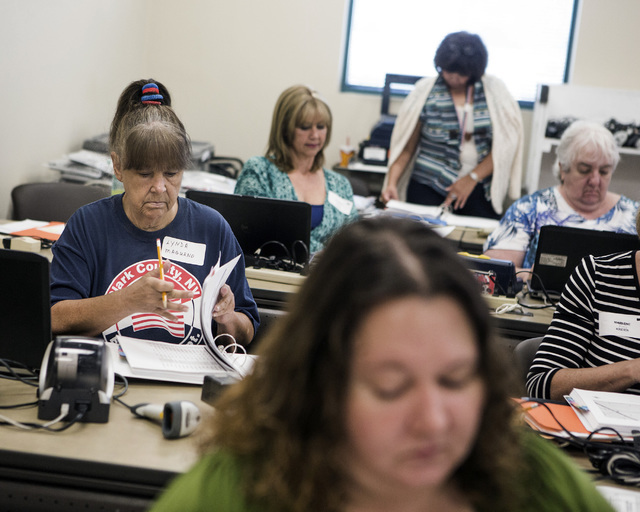 Linda Magurno,left, flip through pages during training for poll workers at the Clark County Elections Department warehouse, 965 Trade Drive, North Las Vegas, on Thursday, May 12, 2016. Jeff Scheid ...