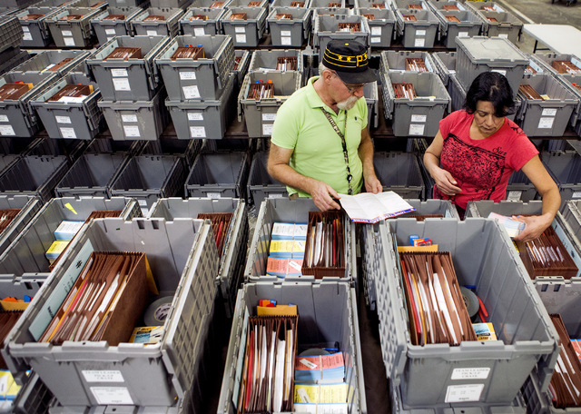 Warehouse personal Ron Moidel, left, and Maria Valdez, checks supplies in a team leader pickup crate at the Clark County Elections Department warehouse, 965 Trade Drive, North Las Vegas, on Thursd ...