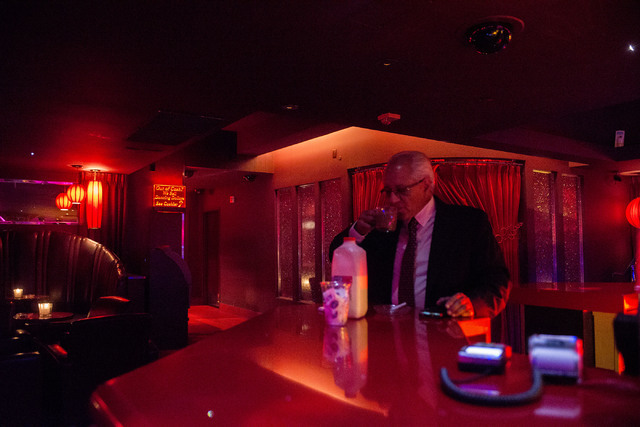 General manager Rudy Nino smokes a cigaret with a cup of coffee at the beginning of his shift at Girls of Glitter Gulch in downtown Las Vegas on May 24, 2016. (Bridget Bennett/Las Vegas Review-Jou ...