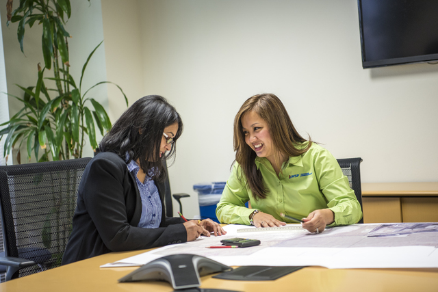 "Kamakshi Sistla, left, and Kathryn Leonardo work on designs at the Parsons Brinkerhoff office in Las Vegas on Thursday, May 26, 2016. Both ladies recently won ""young engineer of the year& ..."