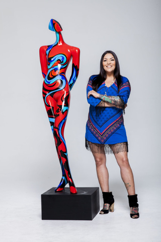 Fawn Douglas poses with the art she created for ArtLIVE!, a charity event combining fashion and art in a showcase to benefit the Las Vegas Fashion Council and 18b Arts District. It is scheduled fr ...