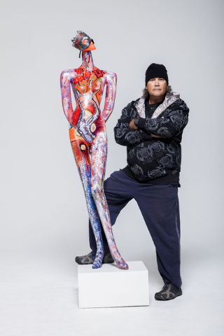 Ruzo Logic poses with the art he created for ArtLIVE!, a charity event combining fashion and art in a showcase to benefit the Las Vegas Fashion Council and 18b Arts District. It is scheduled from  ...