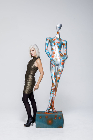 Nancy Good poses with the art she created for ArtLIVE!, a charity event combining fashion and art in a showcase to benefit the Las Vegas Fashion Council and 18b Arts District. It is scheduled from ...