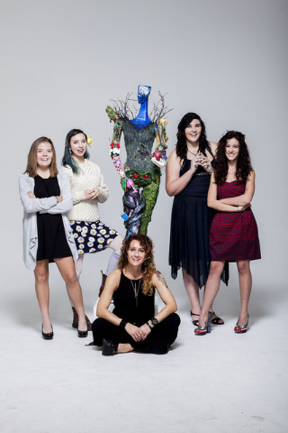 Las Vegas Academy students pose with the art they created for ArtLIVE!, a charity event combining fashion and art in a showcase to benefit the Las Vegas Fashion Council and 18b Arts District. It i ...