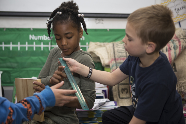 Jaiden Sample, 7, left, and Grayson Levitt, 8, use a ruler to measure wood during their 3-D wood carving process at Discovery Charter School April 27, 2016, in Las Vegas. Erik Verduzco/View