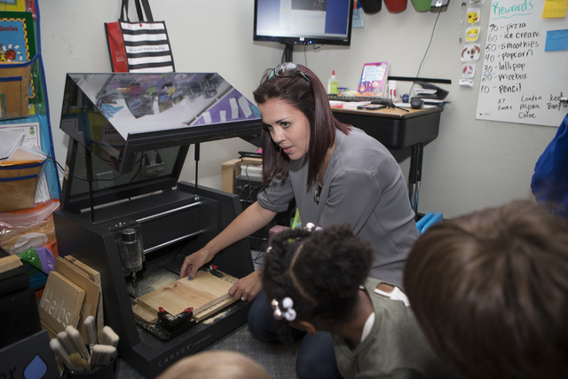 Amanda Kettleson instructs her students in their 3-D wood carving process at Discovery Charter School April 27, 2016. Erik Verduzco/View