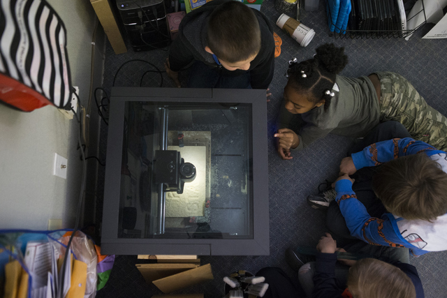 Students watch the 3-D wood carving process at Discovery Charter School April 27, 2016. Erik Verduzco/View
