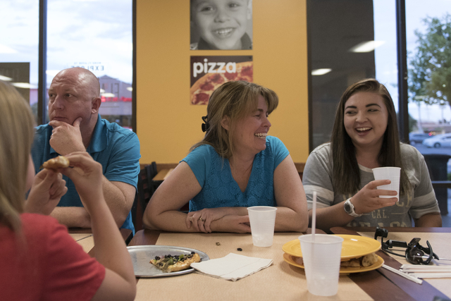 The Sly family eats dinner at CiCi's Pizza at 309 N. Nellis Blvd. in Las Vegas Tuesday, April 26, 2016. From left, Joe, Stacey and Shayla sit around the table with additional family members. (Jaso ...