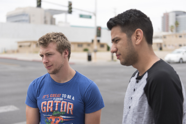 From left, Kyle Knauer, 20, and Javier Ramirez, 21, of Tampa, Florida speak with a reporter about how they could cope with a surprise $1,000 bill near 7th Street and Carson Street in downtown Las  ...