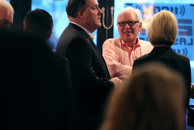 Bill Foley talks to Steve Eanes, left, a member of the Founding 75, at an event to promote season ticket sales for a potential NHL franchise Tuesday, March 24, 2015 at Born and Raised bar. (Sam Mo ...