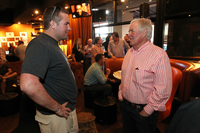 Bill Foley talks to hockey fan John Jacob Jordan at an event to promote season ticket sales for a potential NHL franchise Tuesday, March 24, 2015 at Born and Raised bar. (Sam Morris/Las Vegas Revi ...