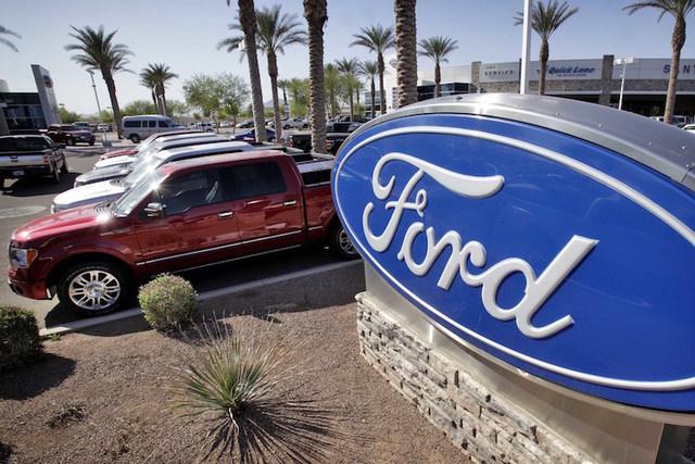 Ford F-150 trucks are shown at a dealership in Glbert, Ariz. (Matt York/AP)