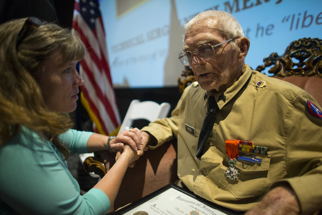 Barbara Lynn Henderson, left, speaks with World War II veteran Tech. Sgt. Elmer J. Hess, 98, who was presented with a French Legion of Honor medal on Wednesday, April 20, 2016 in Las Vegas. Hess,  ...