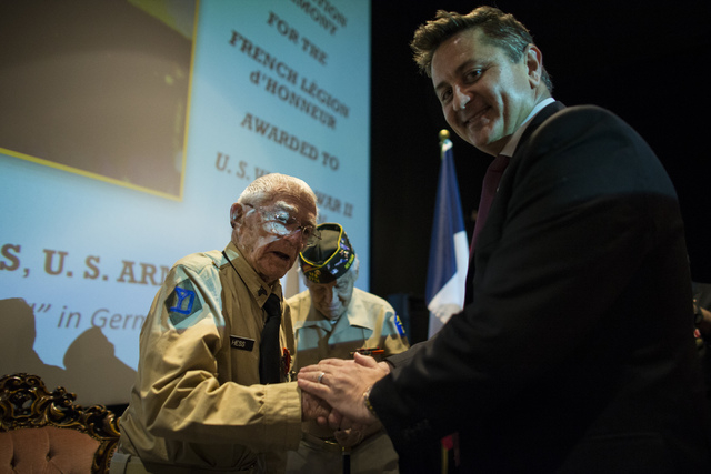 Honorary Consul for Southern Nevada Eric Auger, right, presents World War II veteran Tech. Sgt. Elmer J. Hess, 98, with the French Legion of Honor medal at Wayne Newton's Casa de Shenandoah Visito ...