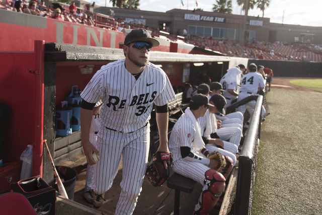 UNLV's Christian Myers, left, exits the dugout for the field during a game against Fresno State at UNLV's Earl E. Wilson Baseball Stadium Friday, May 13, 2016. Jason Ogulnik/Las Vegas Review-Journal