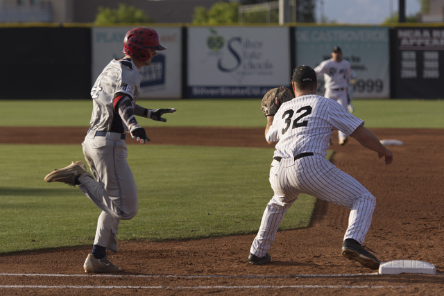 UNLV's Corey Pool, right, catches a ball at first base during a game against Fresno State at UNLV's Earl E. Wilson Baseball Stadium Friday, May 13, 2016. Jason Ogulnik/Las Vegas Review-Journal