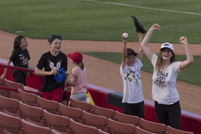 Children celebrate after being tossed a foul ball by a Fresno State player at UNLV's Earl E. Wilson Baseball Stadium Friday, May 13, 2016. Jason Ogulnik/Las Vegas Review-Journal