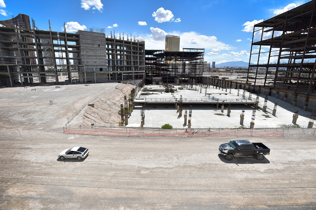 Two vehicles drive by on the construction site of Resorts World Las Vegas along the Strip Monday, May 2, 2016, in Las Vegas. The property, site of Boyd Gaming's mothballed Echelon project, purchas ...