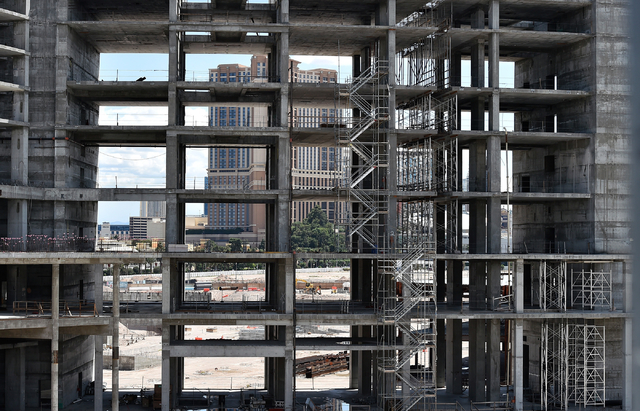 The Palazzo hotel-casino is seen though one of the towers under construction at Resorts World Las Vegas along the Strip Monday, May 2, 2016, in Las Vegas. The property, site of Boyd Gaming's mothb ...