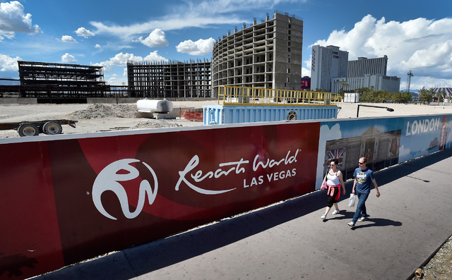 People walk by the construction site of Resorts World Las Vegas along the Strip Monday, May 2, 2016, in Las Vegas. The property, site of Boyd Gaming's mothballed Echelon project, purchased by Mala ...