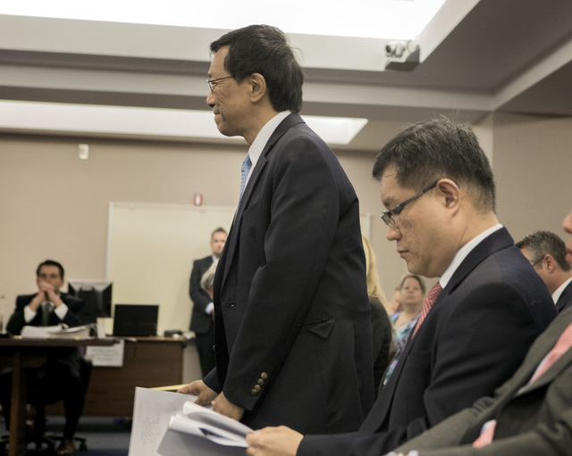 Kok Thay Lim, center, chairman and CEO of Genting Group, and Kong Leong Chong, president an COO of Genting Group appears before the Gaming Control Board for licensing on Wednesday, May 4, 2016. Th ...
