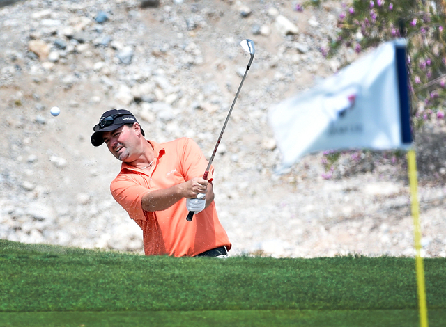 Golfer Monte Montgomery hits out of the bunker at the fifth hole during the U.S. Open local qualifying play at TPC Summerlin on Monday, May 11, 2015, in Las Vegas. (David Becker/Las Vegas Review-J ...