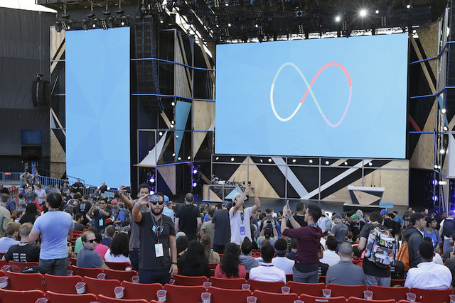 People take selfies before the start of the keynote address of the Google I/O conference, Wednesday, May 18, 2016, in Mountain View, Calif. Google planned to release its vision for phones, cars, v ...