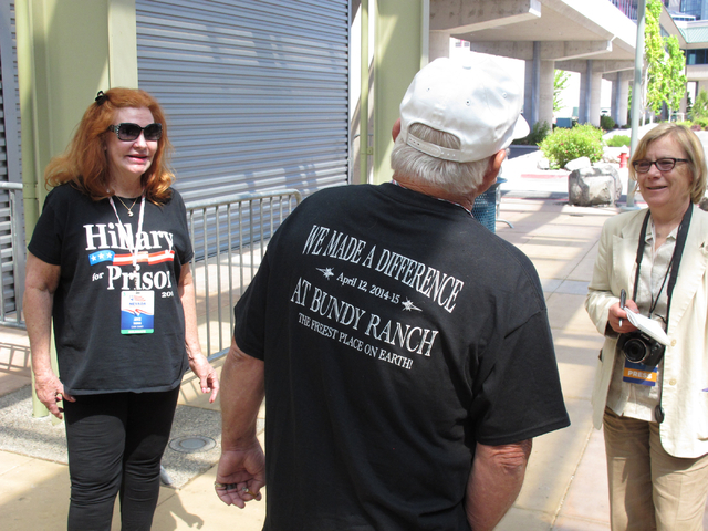 Clark County Republican delegates Joice Thomas, left, and Robert Crooks, center, talk to a reporter outside the Nevada GOP State Convention in Reno on Saturday, May 14, 2016. (Scott Sonner/Associa ...
