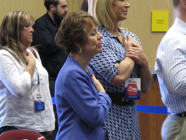 Republican U.S. Senate candidate Sharron Angle, center, recites the pledge of allegiance during the Nevada GOP State Convention in Reno on Saturday, May 14, 2016. (Scott Sonner/Associated Press)