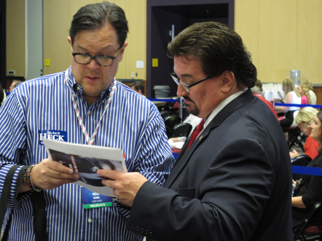 Nevada Republican Party Chairman Michael McDonald, right, talks to Clark County GOP delegate Keith Ozawa during the Nevada GOP State Convention in Reno on Saturday, May 14, 2016. (Scott Sonner/Ass ...