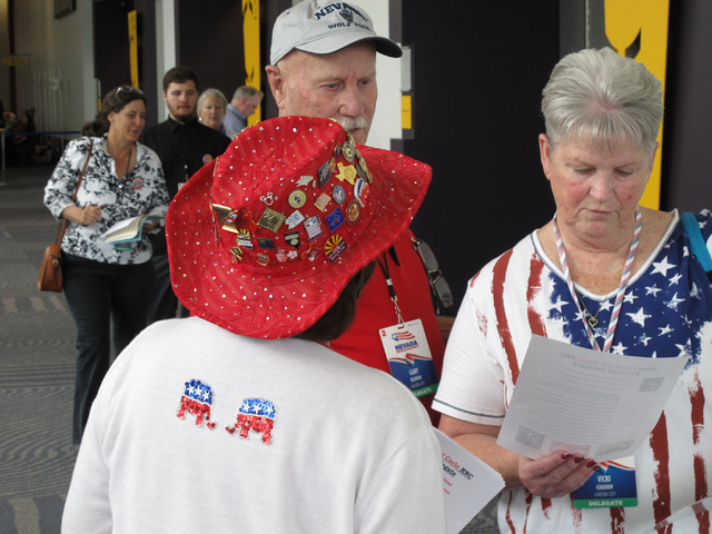 Carol Del Carlo, a Washoe County delegate from Incline Village with her back to the camera, talks with Carson City delegates Gary Beaman and Vicki Graham in Reno on Saturday, May 14, 2016. (Scott  ...