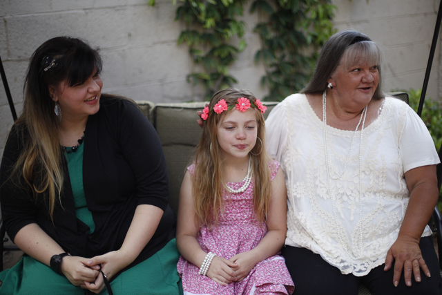 Amanda Llewellyn, from left, her daughter Kairi and her mother Cherlyn Branton hang out on the front porch of Branton's home in Las Vegas Sunday, May 1, 2016. (Rachel Aston/Las Vegas Review-Journa ...