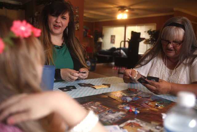 Kairi, far left, her mother Amanda Llewellyn, and her grandmother Cherlyn Branton play Clue at Branton's home in Las Vegas Sunday, May 1, 2016. (Rachel Aston/Las Vegas Review-Journal) Follow @rook ...