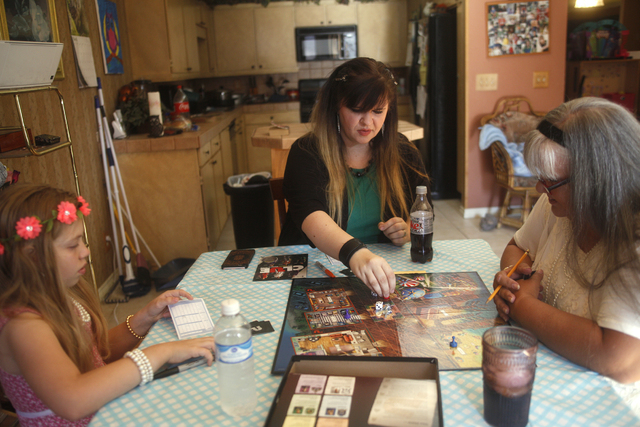 Kairi, from left, her mother Amanda Llewellyn, and grandmother Cherlyn Branton play Clue at Branton's home in Las Vegas Sunday, May 1, 2016. (Rachel Aston/Las Vegas) Follow @rookie__rae