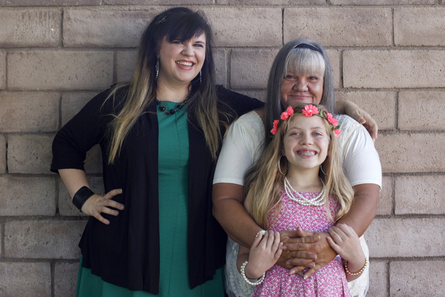 Amanda Llewellyn, from left, her mother Cherlyn Branton, and her daughter Kairi pose for a photo at Branton's home in Las Vegas Sunday, May 1, 2016. (Rachel Aston/Las Vegas Review-Journal) Follow  ...