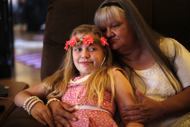 Kairi and her grandmother Cherlyn Branton sit together in Branton's home in Las Vegas Sunday, May 1, 2016. (Rachel Aston/Las Vegas Review-Journal) Follow @rookie__rae