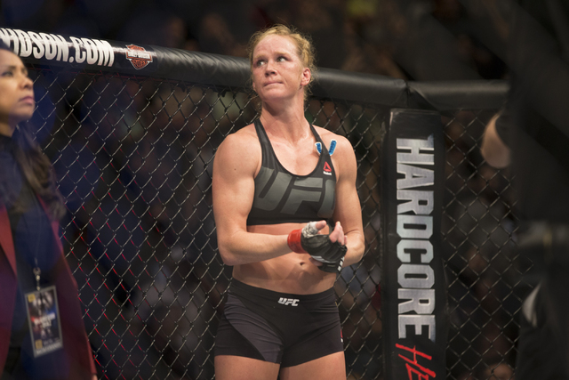 Holly Holm looks on after her loss by way of submission against Miesha Tate in their women's bantamweight title bout during UFC 196 at MGM Grand Garden ArenaSaturday, March 5, 2016, in Las Vegas ...