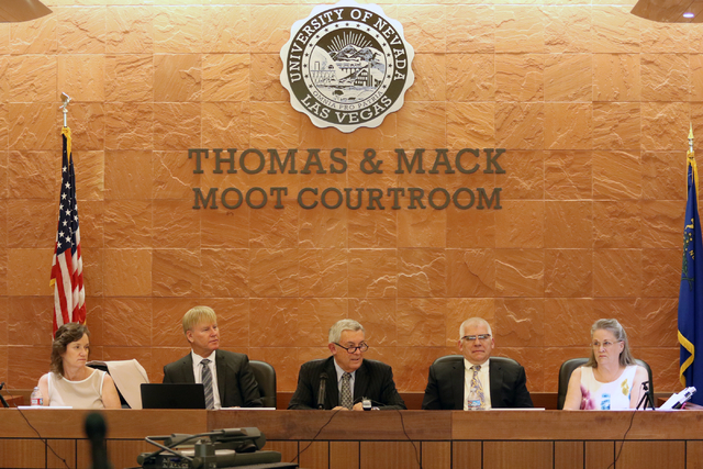 Nevada Supreme Court Chief Justice James Hardesty, center, moderates a meeting of the Nevada Supreme Court commission studying the state's guardianship system at UNLV's Thomas & Mack Moot Cour ...